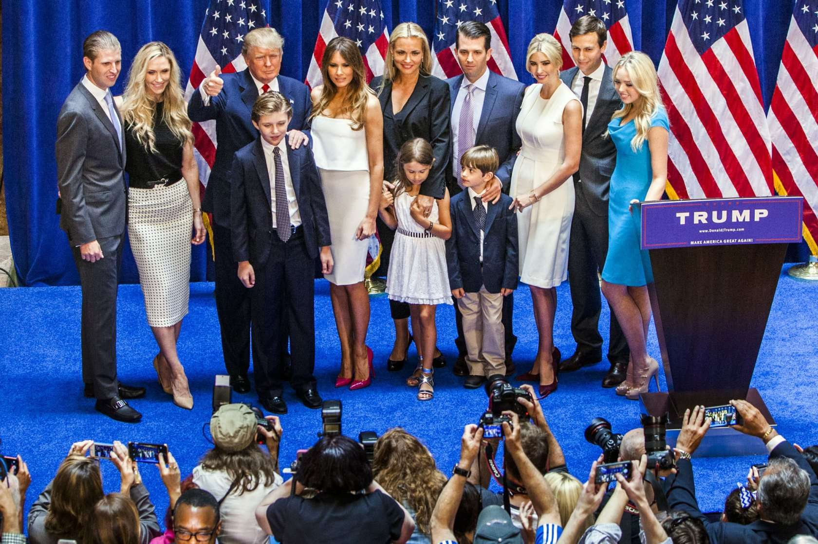 NEW YORK, NY - JUNE 16:   (L-R) Eric Trump, Lara Yunaska Trump, Donald Trump, Barron Trump, Melania Trump, Vanessa Haydon Trump, Kai Madison Trump, Donald Trump Jr., Donald John Trump III, Ivanka Trump, Jared Kushner, and Tiffany Trump pose for photos on stage after Donald Trump announced his candidacy for the U.S. presidency at Trump Tower on June 16, 2015 in New York City. Trump is the 12th Republican who has announced running for the White House.  (Photo by Christopher Gregory/Getty Images)