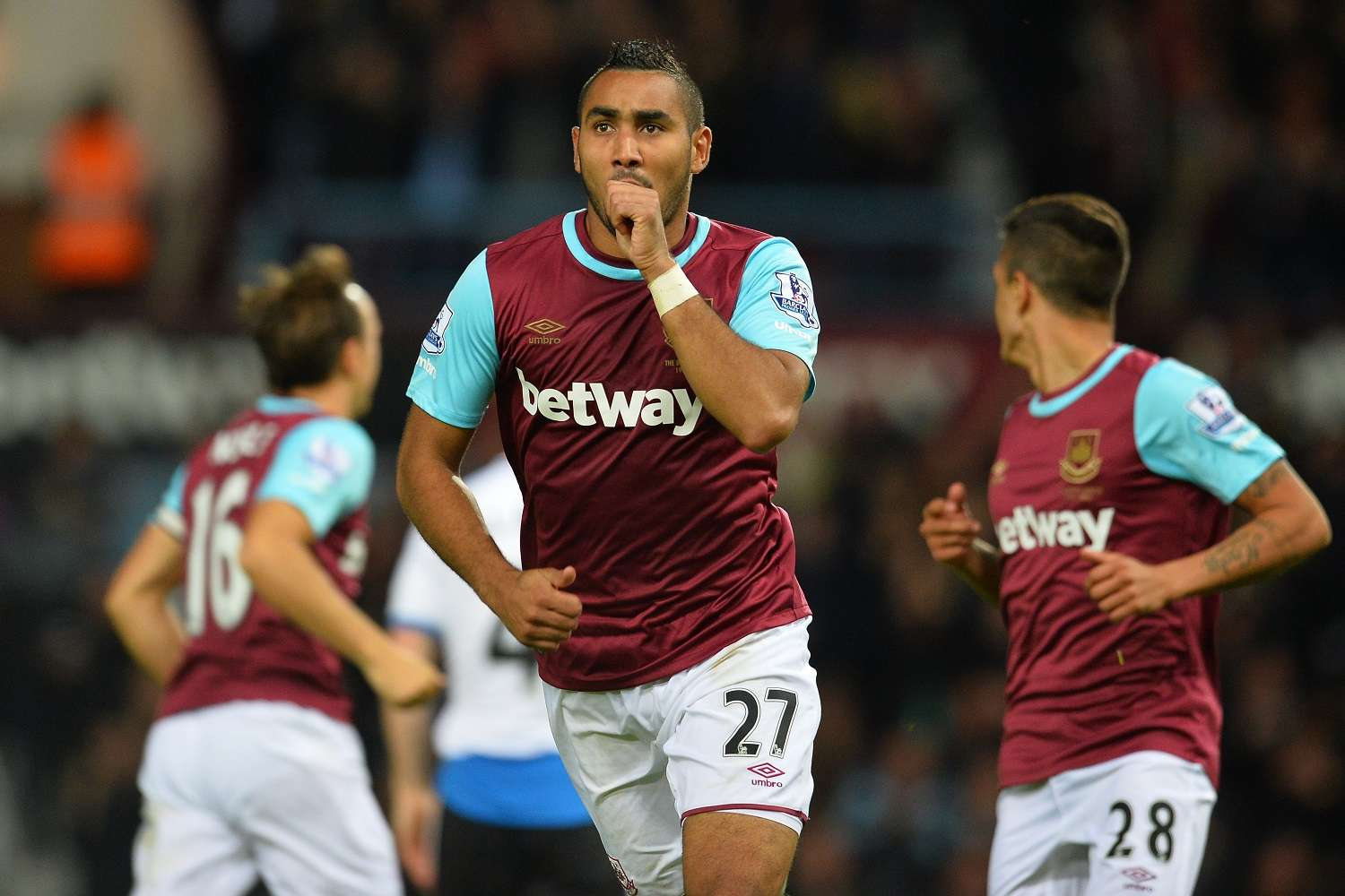 West Ham United's French midfielder Dimitri Payet celebrates scoring his second goal during the English Premier League football match between West Ham United and Newcastle United at The Boleyn Ground in Upton Park, East London on September 14, 2015.   AFP PHOTO / GLYN KIRK RESTRICTED TO EDITORIAL USE. NO USE WITH UNAUTHORIZED AUDIO, VIDEO, DATA, FIXTURE LISTS, CLUB/LEAGUE LOGOS OR 'LIVE' SERVICES. ONLINE IN-MATCH USE LIMITED TO 75 IMAGES, NO VIDEO EMULATION. NO USE IN BETTING, GAMES OR SINGLE CLUB/LEAGUE/PLAYER PUBLICATIONS.        (Photo credit should read GLYN KIRK/AFP/Getty Images)